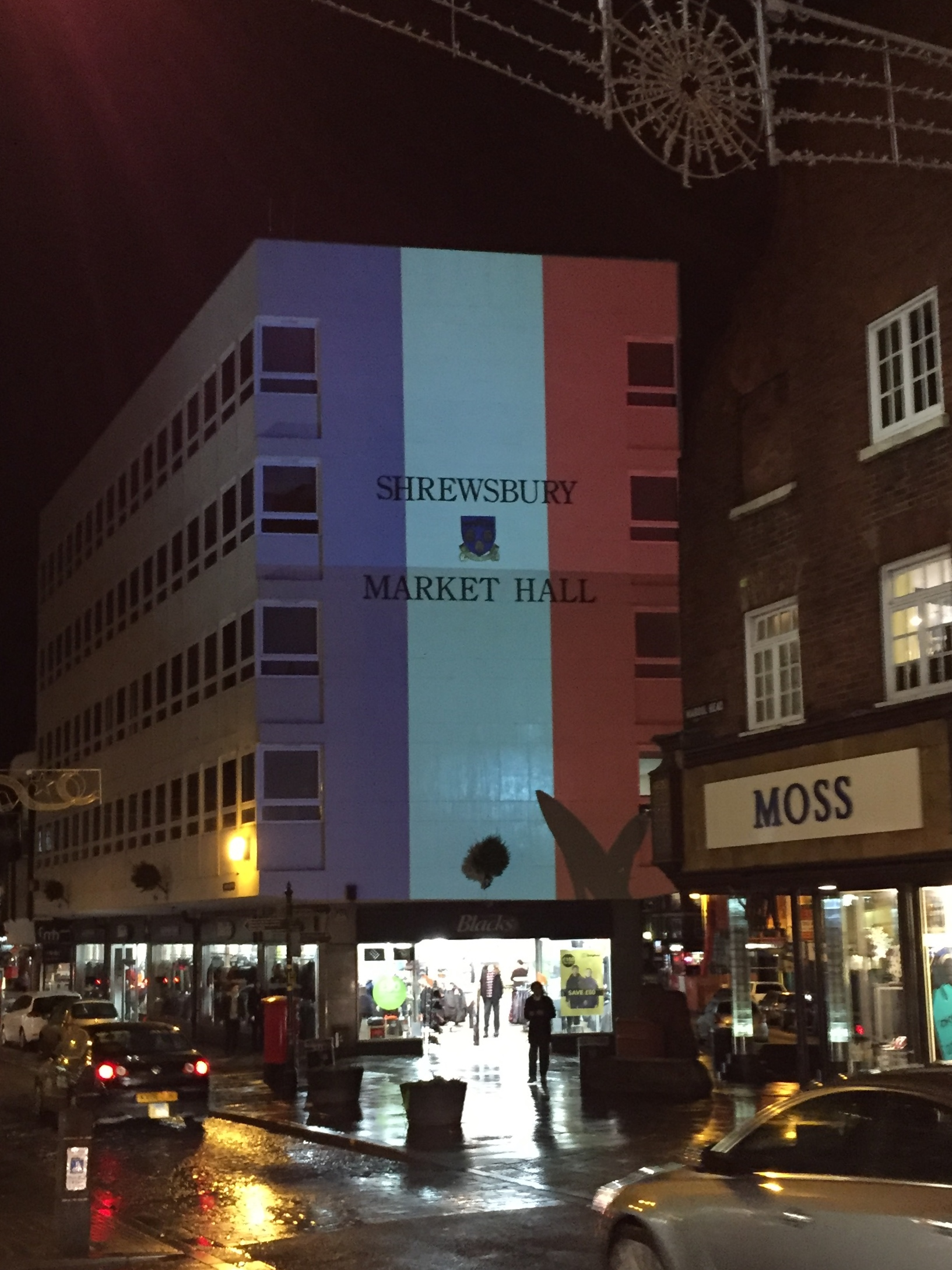 Shrewsbury Market Hall illuminated in solidarity with Paris following November attached. Tricolore tribute