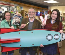 Lottie Clark of the Belle Vue Arts Festival, John Hall of Write Here and customer Lynsey Shale. Events in Shrewsbury