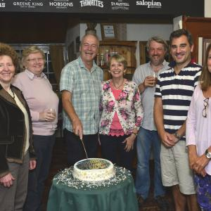 Wace Morgan senior staff pictured cutting the celebration cake, from left: Fiona Barnes, Debby Gittins, Jeremy Taylor, Diana Packwood, Keir Hirst, Chris Detheridge and Zara Oliver.
