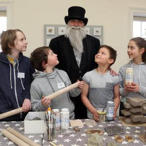 Charles Darwin and participants of Darwin Rocks